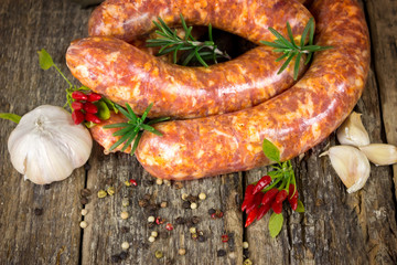 Raw sausages with garlic, rosemary and chili peppers