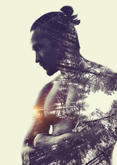 Double exposure :  muscular young man and  forest
