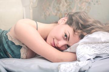 Beautiful girl lying in bed