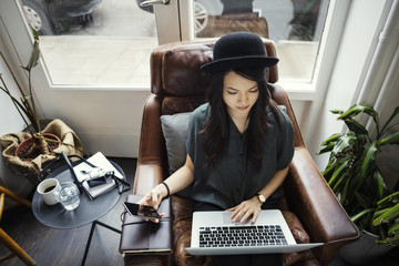 High angle view of businesswoman working while sitting on chair