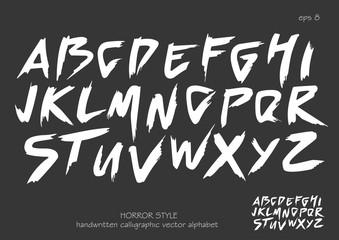 Alphabet vector set of white capital handwritten letters on black background. Handwritten italic font with brush strokes in horror style.