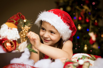Surprised Christmas Child in Santa Hat