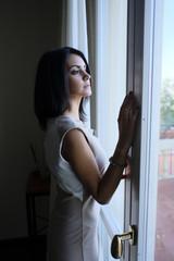 black hair Model girl near window