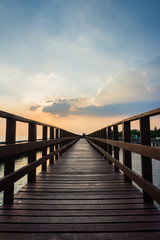 Wooden beach walkway in the evening, a nature trail in Bangkok, Thailand.