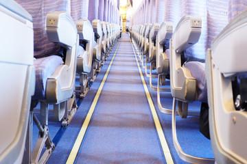 Airplane interior, passenger seat and aisle.