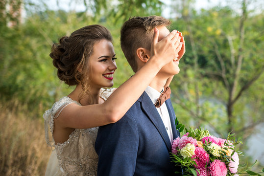 Guess who? The bride and groom in the park, wedding photo shoot. The smiles and cheerful mood