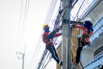 worker on electric pole