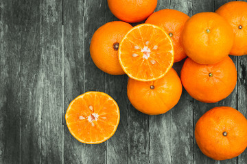 Fresh oranges on wooden table. Group of Fresh Orange on Wood Table Desk Background