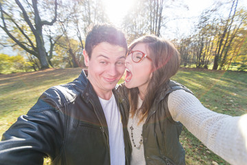Young couple making funny Faces and take a Selfie