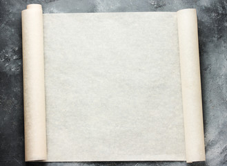 Open roll of baking parchment paper for menu or recipes text