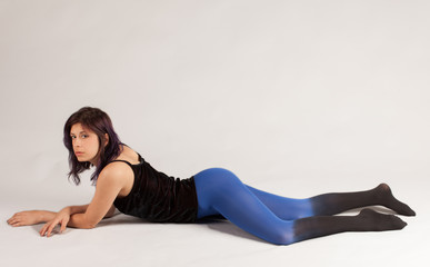 Woman in Velvet Top and Ombre Tights Lying on Belly