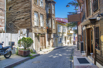 Istanbul street with old traditional wooden houses and filigree sidewalk, Turkey. Golden Horn district.