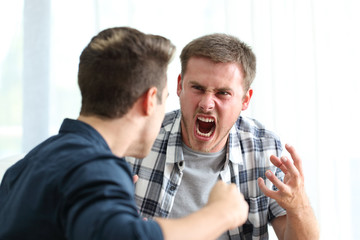 Two angry men arguing and threatening