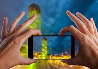 Travel concept. Hand making photo of city with smartphone camera. BATUMI, ADJARA, GEORGIA