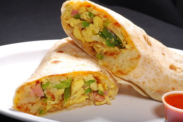 Breakfast Burrito with egg and potatoes inside and red  sauce