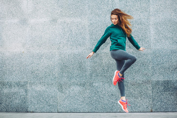 Fitness sport girl in the street Wall mural