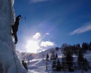 an ice climber on an artificial ice fall in the ski resort of Malbun in Liechtenstein