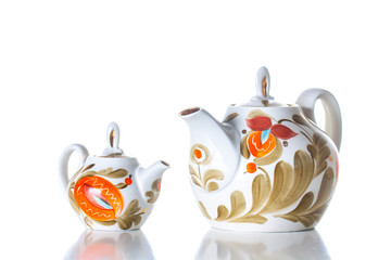 Decorative tea set on white background. Ornamental teapots, Kettles with  colorful countryside style decor