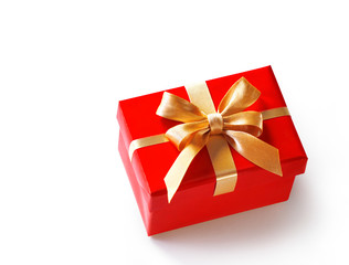 Gift box with golden ribbon on white background. Close up. Copy space. High resolution product