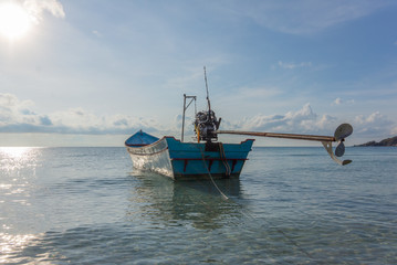 Tropical fishing boat with motor and propeller