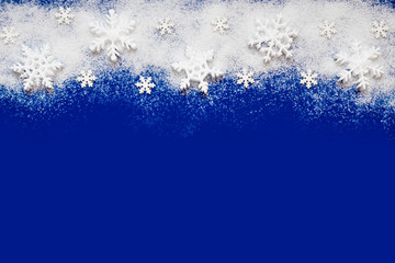 Christmas background with a decorative snowflake on artificial snow