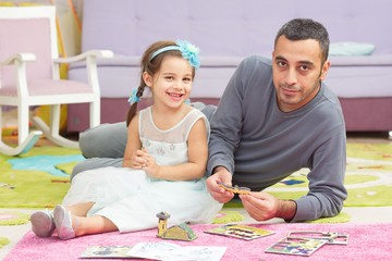 Little Girl Playing With Toys Together With Her Father