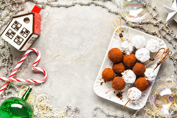 Chocolate truffle candy in Christmas style. festive background w