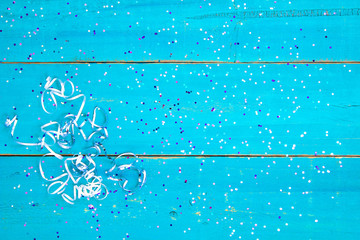 Blank wooden party sign with confetti