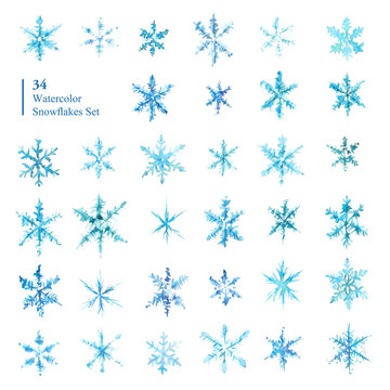 Collection of hand drawn watercolor snowflakes.