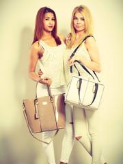 Nice female friends with handbags.