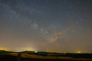 View of a starry night of a tuscan countryside near Siena