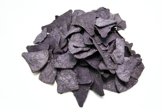 Group of blue corn tortilla chips on white background. Horizontal
