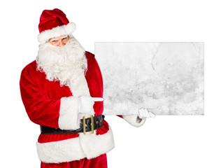 Santa claus holding empty concrete billboard and pointing with his finger on it isolated on white background / weihnachtsmann nikolaus mit leerer Werbetafel isoliert