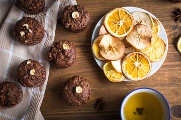 Chocolate cupcakes with orange and tea