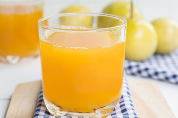 passion fruit and Juice in glass on wood table