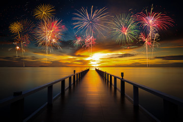 Bridge in the port between sunrise with firework