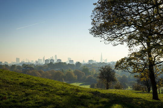 Scenic morning landscape view of London, England from Primrose Hill Park in North London at sunrise