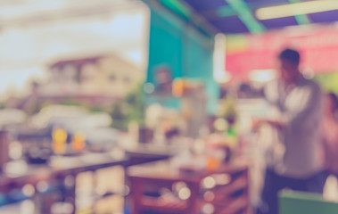 Fotomurales - blur image of coffee shop with bokeh .
