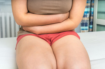 Woman with abdominal pain, stomach or menstrual cramps
