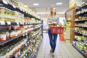 Woman is looking around in grocery store