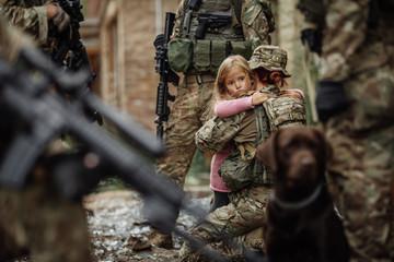 Soldier and children on battlefield background.