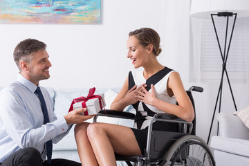 Happy women on wheelchair with partner
