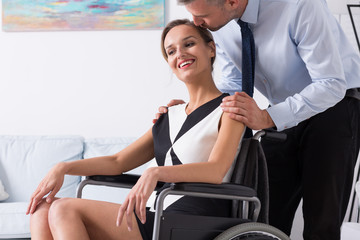 Man kissing women on a wheelchair