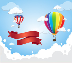 Hot air balloon in the sky with red banner ribbon cloud background