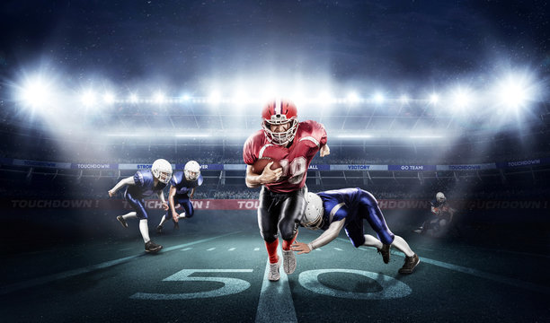 American football players in action on stadium with ball