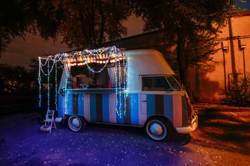Colorful van in garlands