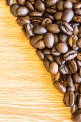 coffee beans on a wood floor.