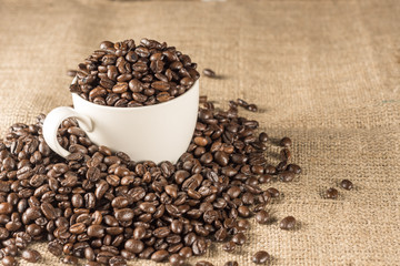 Roasted coffee bean in white cup