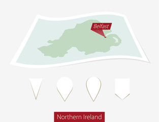 Curved paper map of Northern Ireland with capital Belfast.