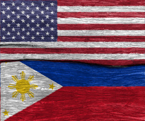 USA flag and philippines flag on wood texture background floor - can use to display or montage on product